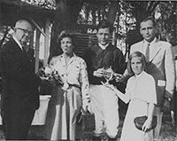 At Fair Hill in 1962, trainer Mikey Smithwick (right) accepted the trophies along with his brother, jockey Paddy Smithwick, and owner June McKnight, whose Narcissus II won the Manly Steeplechase. Maryland Governor J. Millard Tawes (left) presented. The win gave Smithwick title as all-time money-winning trainer.